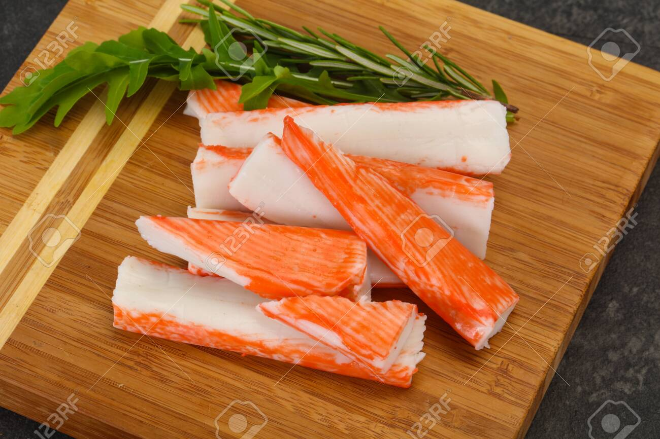 Crab Stick Surimi Over Wooden Board Stock Photo, Picture And ...