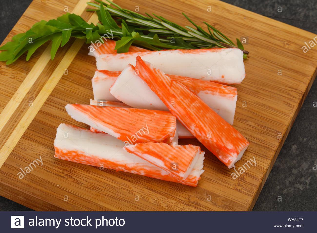 Crab stick surimi over wooden board Stock Photo - Alamy